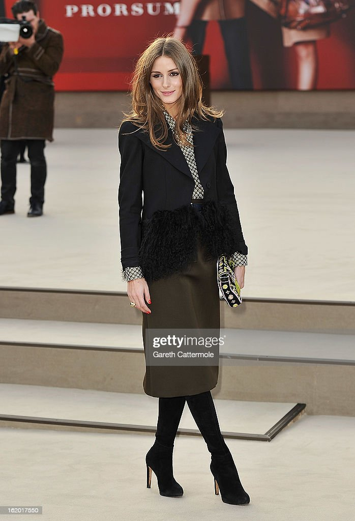 Olivia Palermo wearing Burberry, arrives at the Burberry Prorsum Autumn Winter 2013 Womenswear Show on February 18, 2013 in London, England.