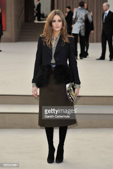 Olivia Palermo wearing Burberry arrives at the Burberry Prorsum Autumn Winter 2013 Womenswear Show on February 18 2013 in London England