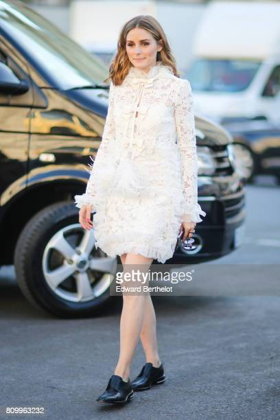 Olivia Palermo wears a white lace dress outside the Giambattista Valli show during Paris Fashion Week Haute Couture Fall/Winter 20172018 on July 3...
