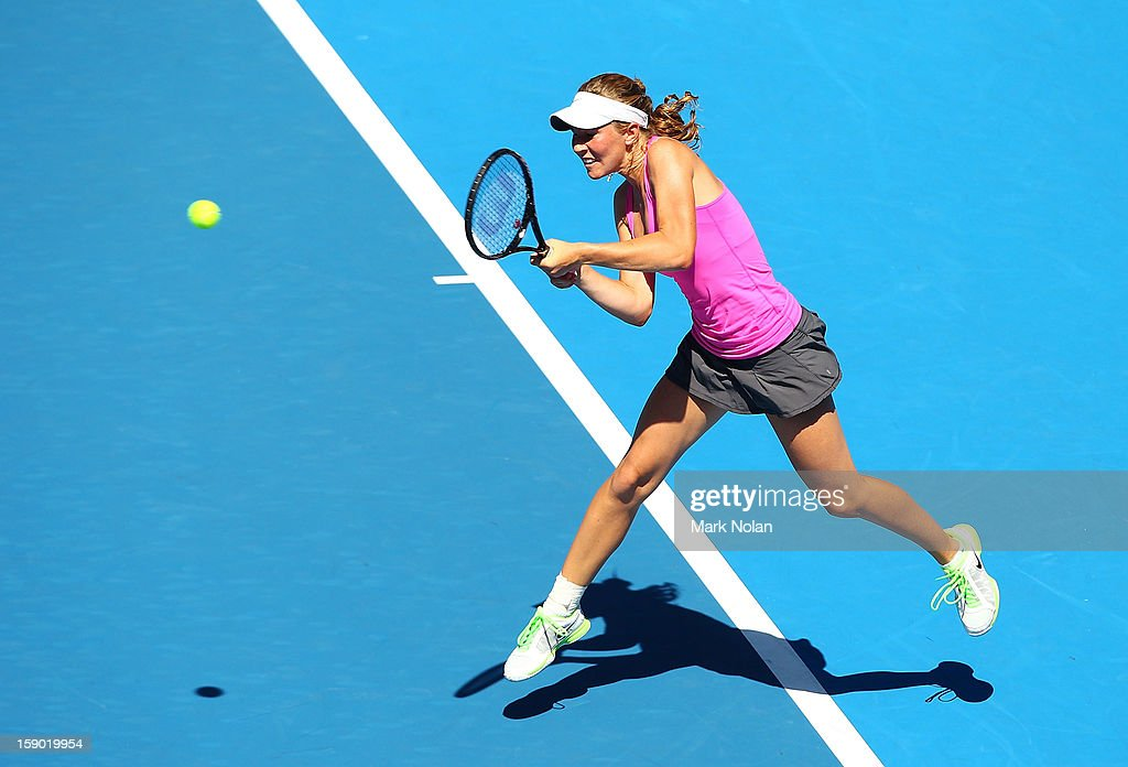 <a gi-track='captionPersonalityLinkClicked' href=/galleries/search?phrase=Olivia+Rogowska&family=editorial&specificpeople=4698702 ng-click='$event.stopPropagation()'>Olivia Rogowska</a> of Australia plays a backhand in her first round match against Maria Kirilenko of Russia during day one of the Sydney International at Sydney Olympic Park Tennis Centre on January 6, 2013 in Sydney, Australia.