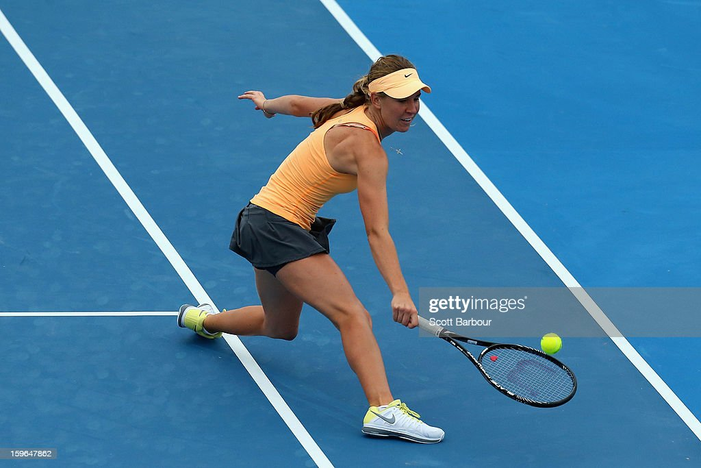 Olivia Rogowska of Australia plays a backhand in their first round mixed doubles match with Marinko Matosevic of Australia against Katarina Srebotnik of Slovenia and Nenad Zimonjic of Serbia during day five of the 2013 Australian Open at Melbourne Park on January 18, 2013 in Melbourne, Australia.