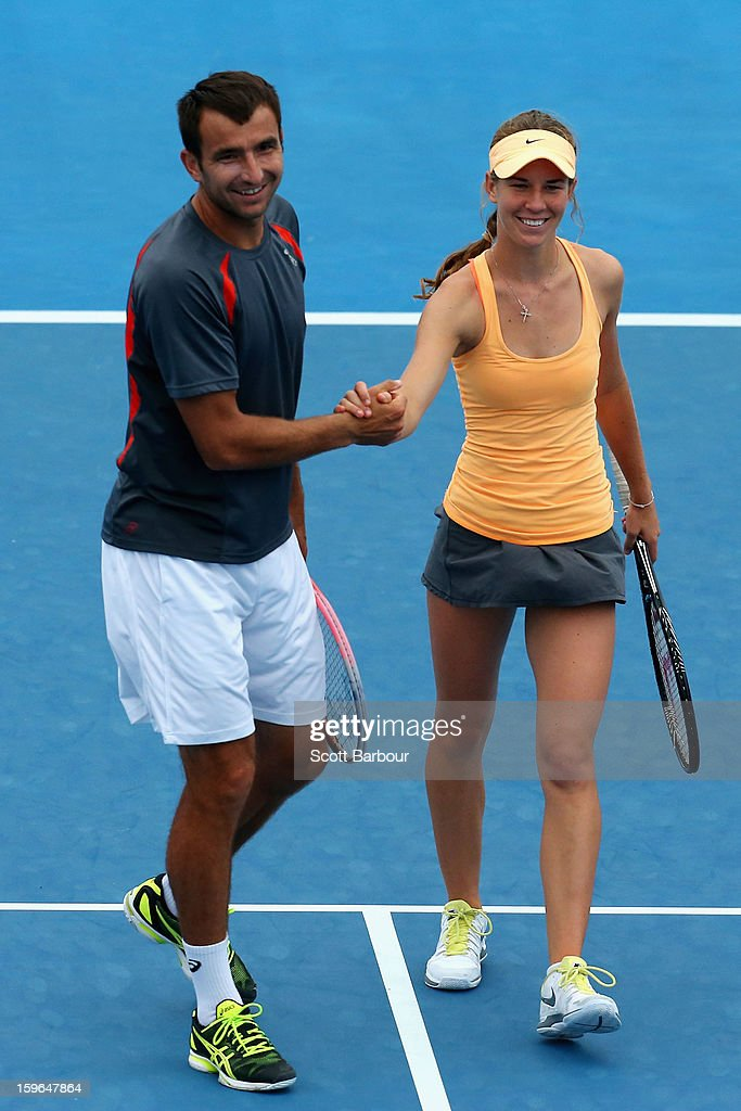 Olivia Rogowska of Australia talks tactics with Marinko Matosevic of Australia in their first round mixed doubles match against Katarina Srebotnik of Slovenia and Nenad Zimonjic of Serbia during day five of the 2013 Australian Open at Melbourne Park on January 18, 2013 in Melbourne, Australia.