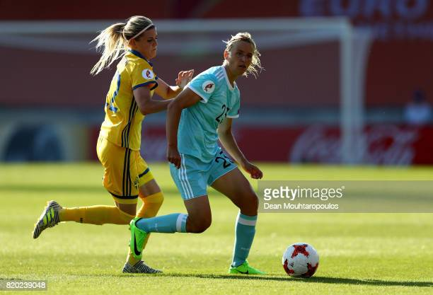 Olivia Schough of Sweden and Elena Morozova of Russia compete for the ball during the Group B match between Sweden and Russia during the UEFA Women's...