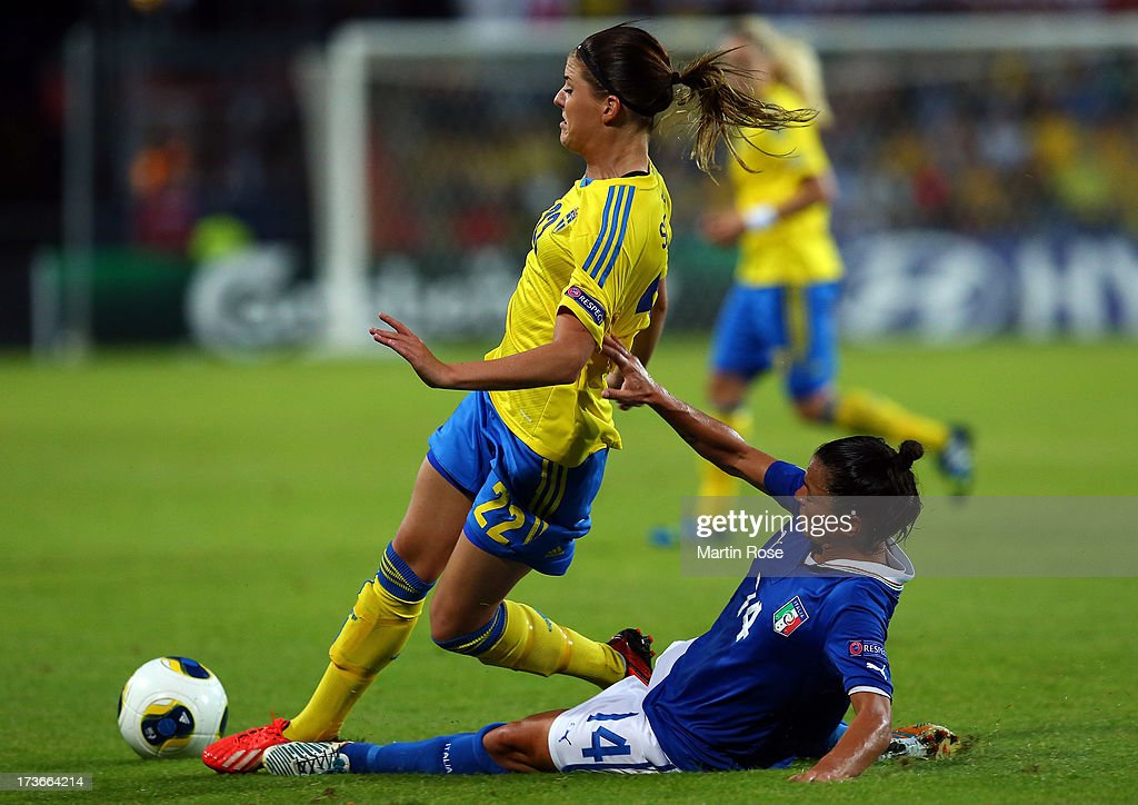 Olivia Schough (L) of Sweden and Sandy Iannella(R) of Italy battle for the ball during the UEFA Women's Euro 2013 group A match between Sweden and Italy at Orjans Vall on July 16, 2013 in Halmstad, Sweden.