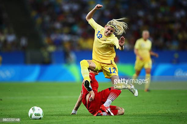 Olivia Schough of Sweden clears the challenge of Alexandra Popp of Germany during the Women's Olympic Gold Medal match between Sweden and Germany at...