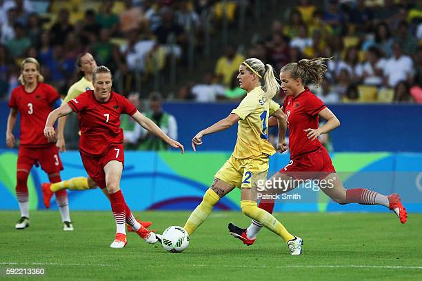 Olivia Schough of Sweden holds off the challenge of Tabea Kemme of Germany and Melanie Behringer of Germany during the Women's Olympic Gold Medal...