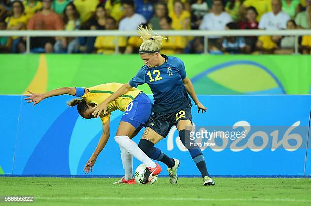 Olivia Schough of Sweden tackles her opponent during the Women's Group E first round match between Brazil and Sweden on Day 1 of the Rio 2016 Olympic...