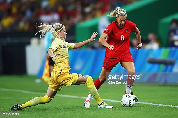 Olivia Schough of Sweden tackles Lena Goessling of Germany during the Women's Olympic Gold Medal match between Sweden and Germany at Maracana Stadium...