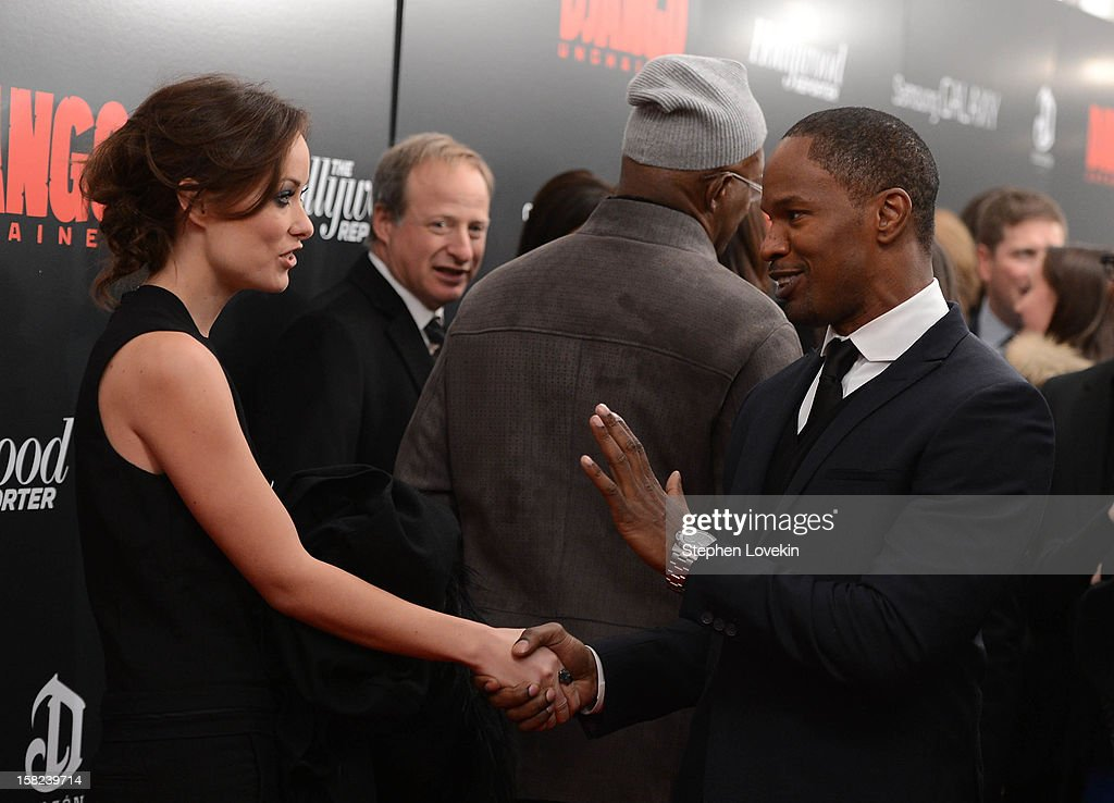 Olivia Wilde and Jamie Foxx attend a screening of 'Django Unchained' hosted by The Weinstein Company with The Hollywood Reporter, Samsung Galaxy and The Cinema Society at Ziegfeld Theater on December 11, 2012 in New York City.