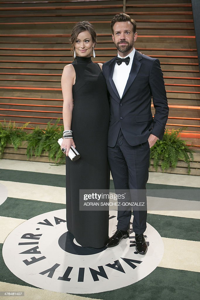 Olivia Wilde (L) and Jason Sudeikis arrive at the 2014 Vanity Fair Oscar Party on March 2, 2014 in West Hollywood, California.