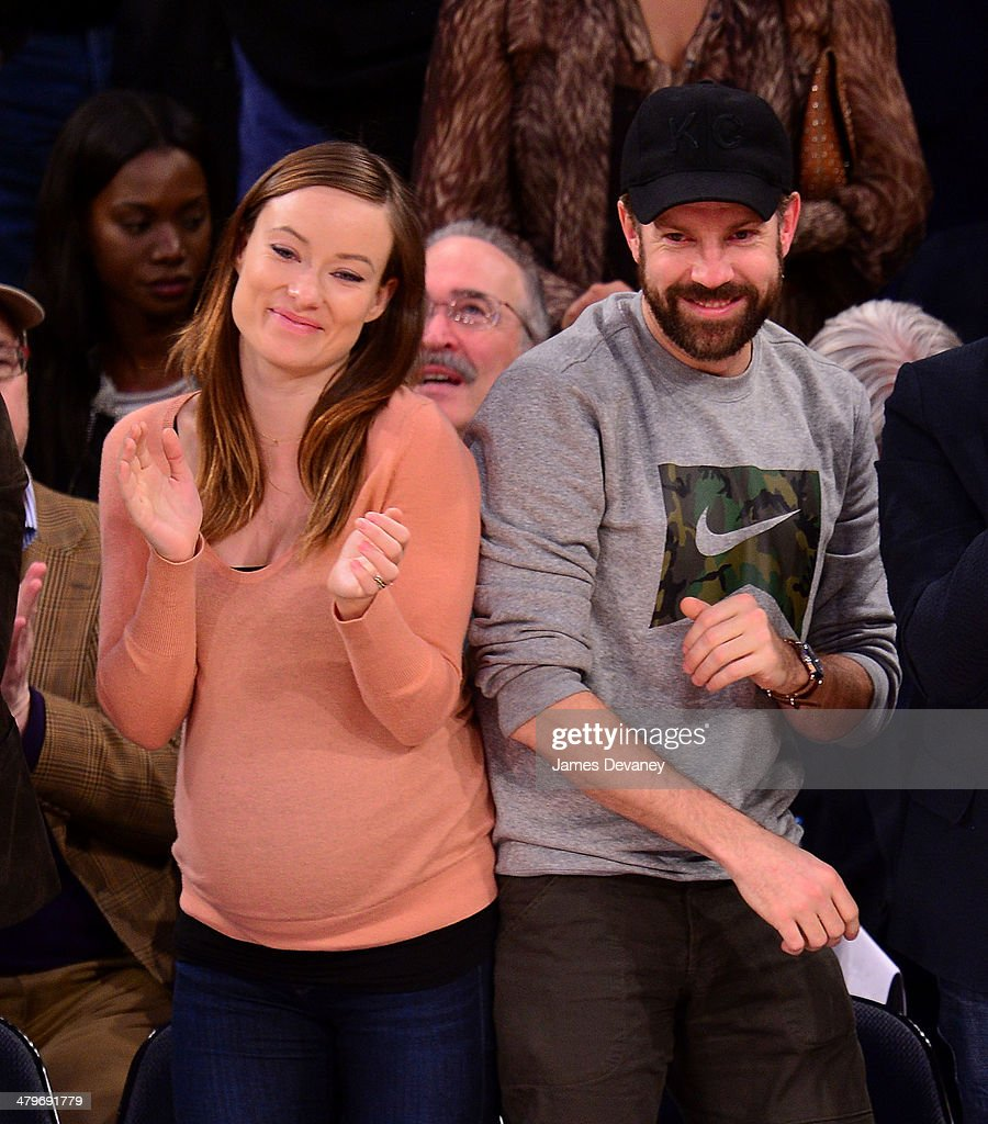 Olivia Wilde and Jason Sudeikis attend the Indiana Pacers vs New York Knicks game at Madison Square Garden on March 19, 2014 in New York City.