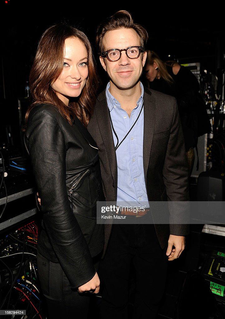 Olivia Wilde and Jason Sudeikis backstage during '12-12-12' a concert benefiting The Robin Hood Relief Fund to aid the victims of Hurricane Sandy presented by Clear Channel Media & Entertainment, The Madison Square Garden Company and The Weinstein Company>> at Madison Square Garden on December 12, 2012 in New York City.