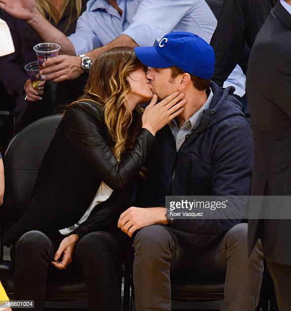 Olivia Wilde and Jason Sudeikis kiss at a basketball game between the San Antonio Spurs and the Los Angeles Lakers at Staples Center on November 1...