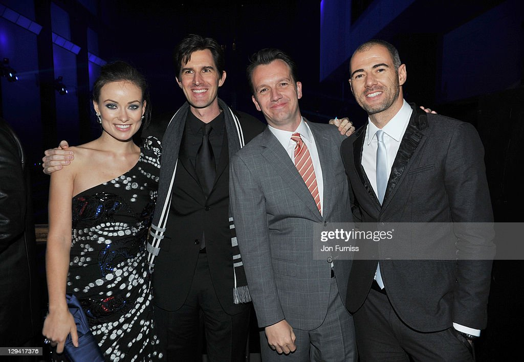 <a gi-track='captionPersonalityLinkClicked' href=/galleries/search?phrase=Olivia+Wilde&family=editorial&specificpeople=235399 ng-click='$event.stopPropagation()'>Olivia Wilde</a>, director <a gi-track='captionPersonalityLinkClicked' href=/galleries/search?phrase=Joseph+Kosinski&family=editorial&specificpeople=7113921 ng-click='$event.stopPropagation()'>Joseph Kosinski</a>, producers Sean Bailey and Daniel Simon attend the 'Tron: Legacy' UK Premiere after party at Tate Modern on December 5, 2010 in London, England.