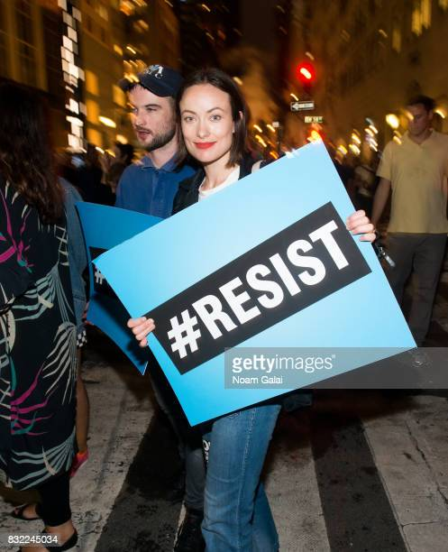 Olivia Wilde joins Michael Moore as he leads his Broadway audience to Trump Tower to protest President Donald Trump on August 15 2017 in New York City