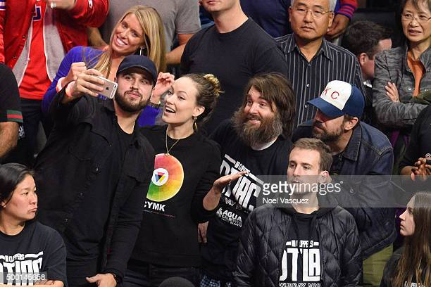 Olivia Wilde Will Forte and Jason Sudeikis take a selfie with a fan at a basketball game between the Orlando Magic and Los Angeles Clippers at...