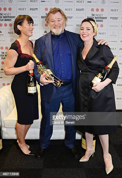 Olivia Williams Brendan Gleeson winner of the Best Actor award for 'Calvary' and Olivia Colman pose at The Moet British Independent Film Awards 2014...