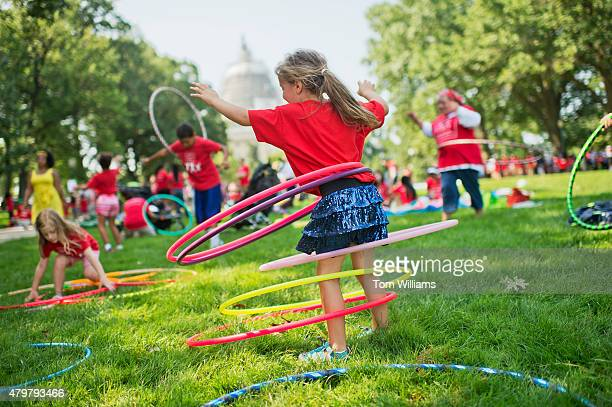 Olivia Yost of Pittsburgh hula hoops during a 'playin' protest by kids and mothers in Upper Senate Park organized by Moms Clean Air Force July 7 2015...