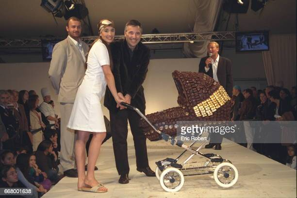 Olivier and Yara Lapidus pushing a pram made by a chocolate maker at Neuville