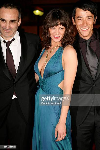 Olivier Assayas Asia Argento and Carl Ng during 2007 Cannes Film Festival 'Boarding Gate' Premiere at Palais des Festivals in Cannes France