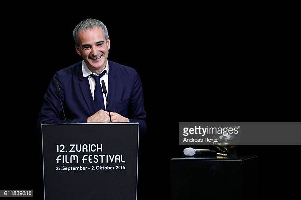 Olivier Assayas gives his acceptance speech after receiving the 'Tribute to' award on stage during the Award Night Ceremony during the 12th Zurich...