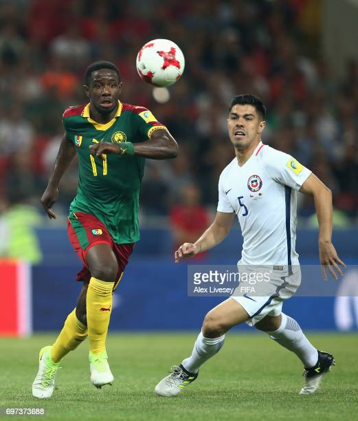 Olivier Boumal of Cameroon attempts to take the ball past Francisco Silva of Chile during the FIFA Confederations Cup Russia 2017 Group B match...