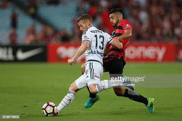 Olivier Bozanic of the Victory is challenged by Bruno Pinatares of the Wanderers during the round 10 ALeague match between the Western Sydney...