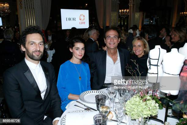 Olivier Coursier of Group AaRon guest Professor Maurice Mimoun and Frederique Fetiveau attend the 'Diner des Amis de Care' at Hotel Peninsula Paris...