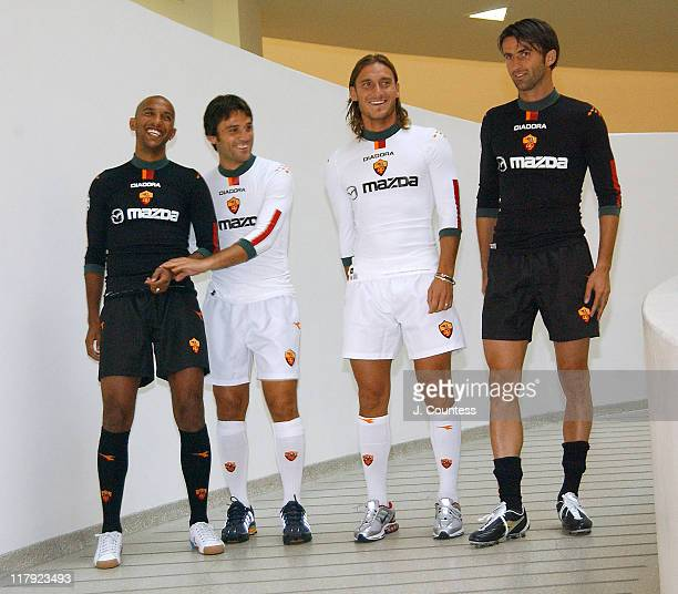Olivier Dacourt Vincenzo Montella and Christian Panucci of team AS ROMA with Francesco Totti captain of team AS ROMA as they model the new AS ROMA...