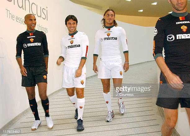 Olivier Dacourt Vincenzo Montella of team AS ROMA with Francesco Totti captain of team AS ROMA and Christian Panucci as they model the new AS ROMA...