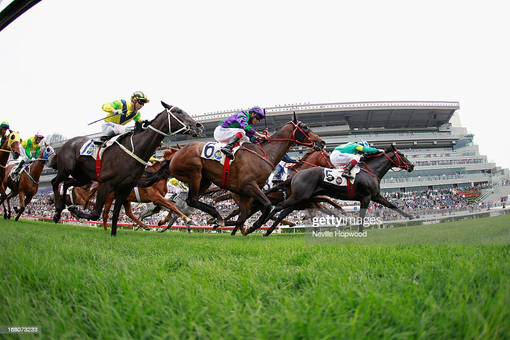 Olivier Delouze rides Happy Kaiser to win the Bering Sea Handicap during The Champions Mile meeting at Sha Tin racecourse on May 5, 2013, in Hong Kong, Hong Kong.