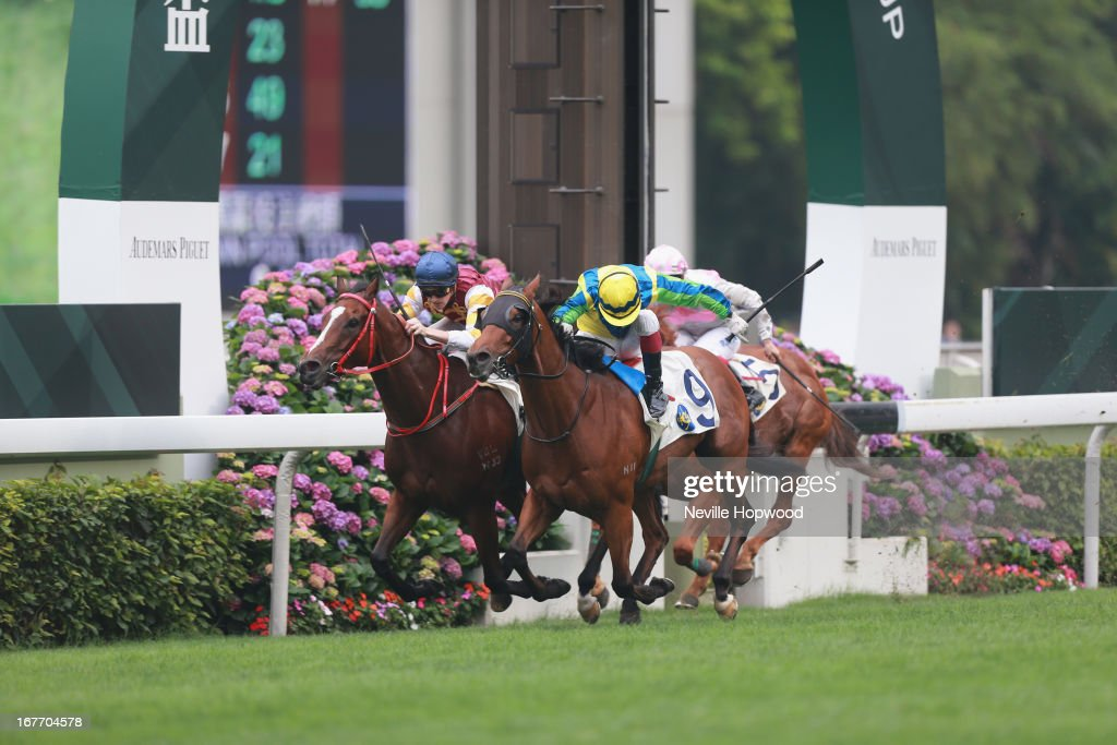 Olivier Delouze riding Rich Tapestary wins The Sprint Cup (right) from Tye Angland riding Go Baby Go during the Audemars Piguet Queen Elizabeth II at Sha Tin racecourse on April 28, 2013 in Hong Kong, Hong Kong.
