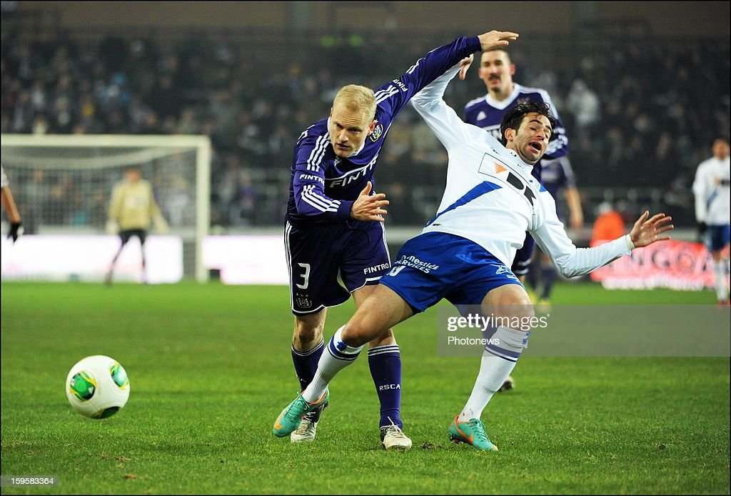 Olivier Deschacht of RSC Anderlecht and Rafael Scapini Rafinha of KAA Gent pictured in action during the Cofidis cup match between RSC Anderlecht vs KAA Gent on January, 2013 in Anderlecht, Belgium.