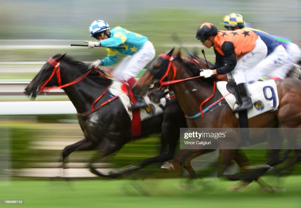 Olivier Doleuze riding Happy Kaiser wins the Bering Sea Handicap during The Champions Mile at Sha Tin racecourse on May 5, 2013, in Hong Kong, Hong Kong.