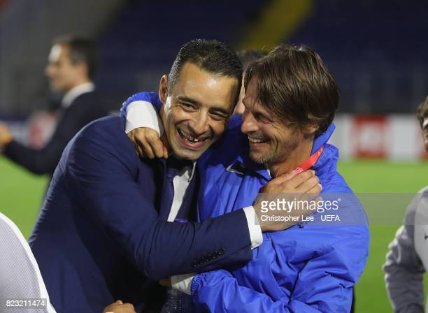 Olivier Echouafni head coach of France celebrates their result with a team member during the UEFA Women's Euro 2017 Group C match between Switzerland...