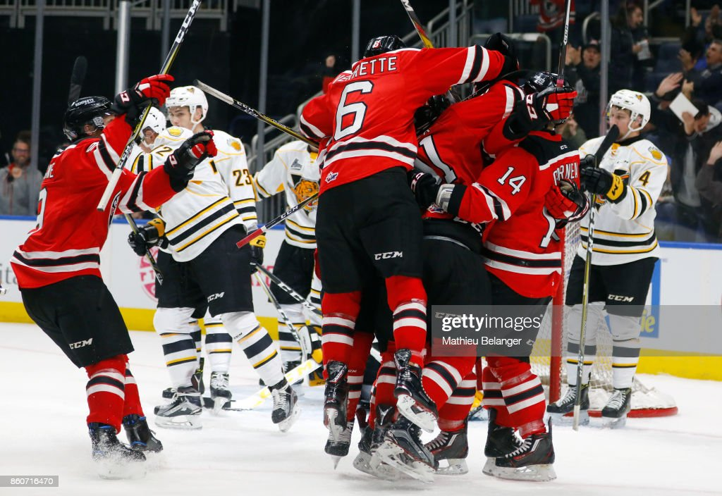 Olivier Garneau #14 of the Quebec Remparts celebrates his game tying goal with his teammates against the Victoriaville Tigres during the third period of their QMJHL hockey game at the Centre Videotron on October 12, 2017 in Quebec City, Quebec, Canada.