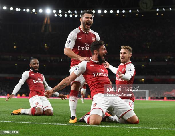 Olivier Girod celebrates scoring the 4th Arsenal goal with Sead Kolasinac and Aaron Ramsey during the Premier League match between Arsenal and...
