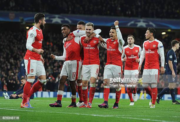 Olivier Giroud Alex Iwobi Aaron Ramsey and Alexis Sanchez celebrate the 2nd Arsenal goal during the UEFA Champions League match between Arsenal FC...