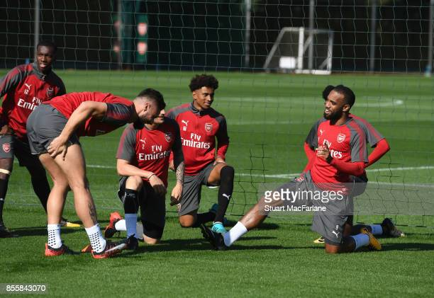 Olivier Giroud and Alex lacazette of Arsenal during a training session at London Colney on September 30 2017 in St Albans England