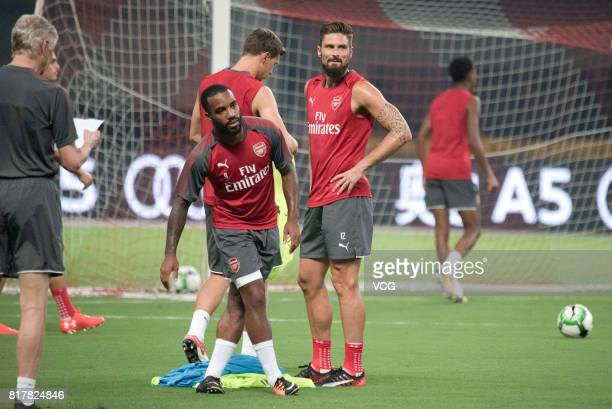 Olivier Giroud and Alexandre Lacazette of Arsenal FC attends a training session ahead of 2017 International Champions Cup football match between...