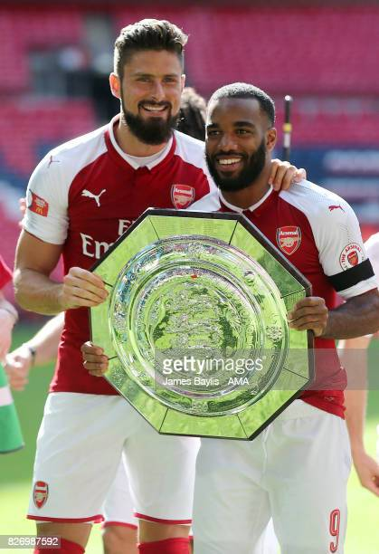 Olivier Giroud and Alexandre Lacazette of Arsenal with the FA Community Shield trophy after the The FA Community Shield between Chelsea and Arsenal...
