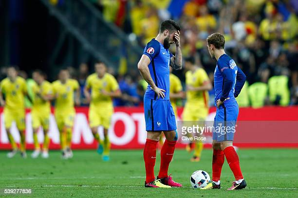 Olivier Giroud and Antoine Griezmann of France react after Romania's first goal during the UEFA Euro 2016 Group A match between France and Romania at...