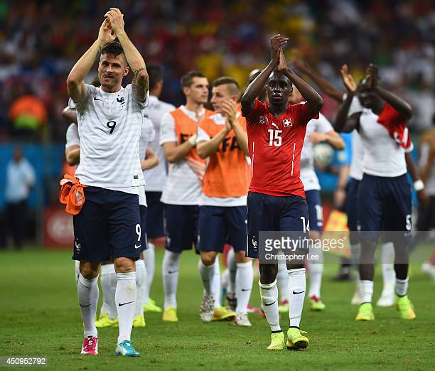 Olivier Giroud and Blaise Matuidi of France acknowledge the fans after defeating Switzerland 52 during the 2014 FIFA World Cup Brazil Group E match...