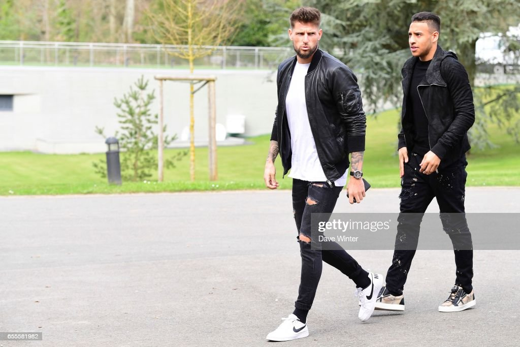 Olivier Giroud and Corentin Tolisso of France arriving at Centre National du Football on March 20, 2017 in Clairefontaine, France.