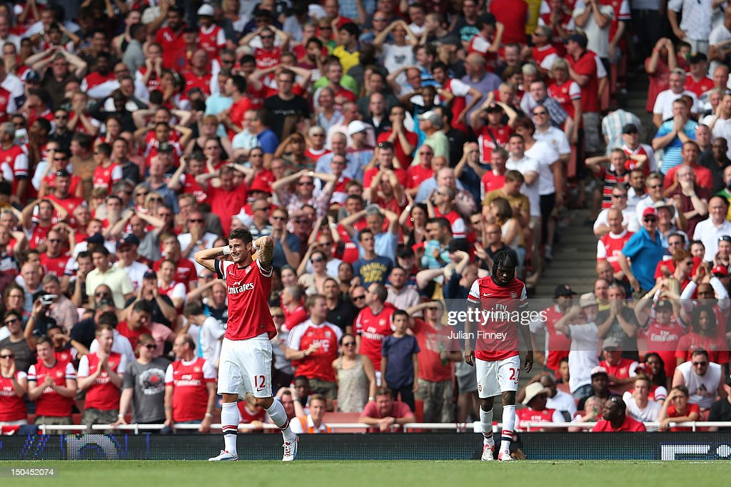 <a gi-track='captionPersonalityLinkClicked' href=/galleries/search?phrase=Olivier+Giroud&family=editorial&specificpeople=5678034 ng-click='$event.stopPropagation()'>Olivier Giroud</a> and <a gi-track='captionPersonalityLinkClicked' href=/galleries/search?phrase=Gervinho&family=editorial&specificpeople=4500752 ng-click='$event.stopPropagation()'>Gervinho</a> of Arsenal react to a play during the Barclays Premier League match between Arsenal and Sunderland at Emirates Stadium on August 18, 2012 in London, England.