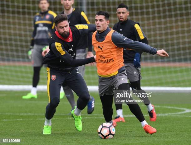 Olivier Giroud and Granit Xhaka of Arsenal during a training session at London Colney on March 10 2017 in St Albans England