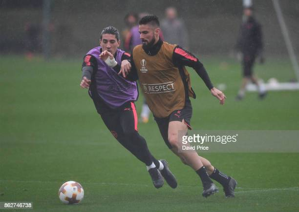 Olivier Giroud and Hector Bellerin of Arsenal during the Arsenal Training Session at London Colney on October 18 2017 in St Albans England
