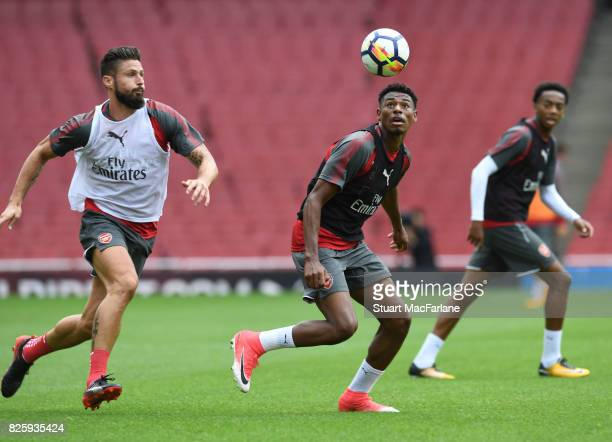Olivier Giroud and Jeff ReineAdelaide of Arsenal during a training session at Emirates Stadium on August 3 2017 in London England