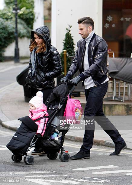 Olivier Giroud and Jennifer Giroud are pictured having a family day out on February 22 2015 in London England