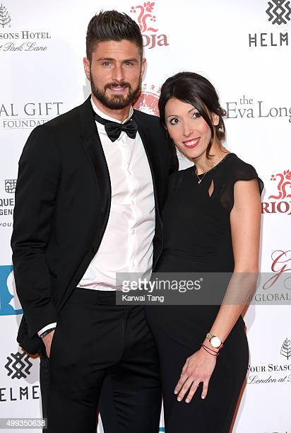 Olivier Giroud and Jennifer Giroud attend The Global Gift Gala at Four Seasons Hotel on November 30 2015 in London England